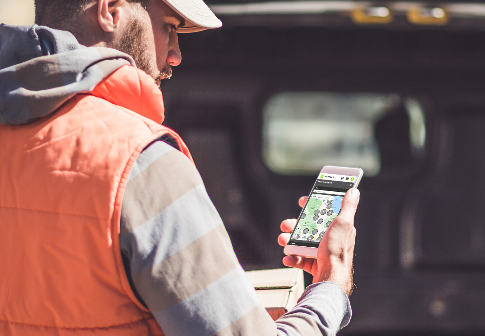 delivery driver using maps on his mobile for his route schedule