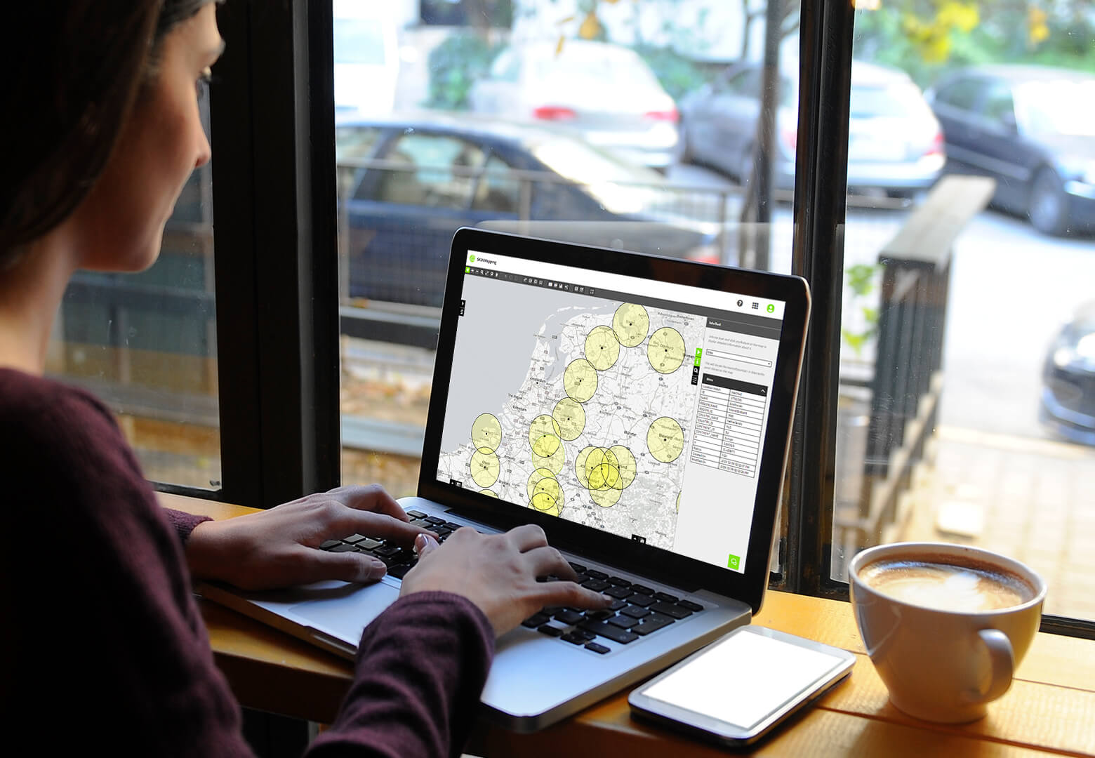 woman analysing geographical coverage map